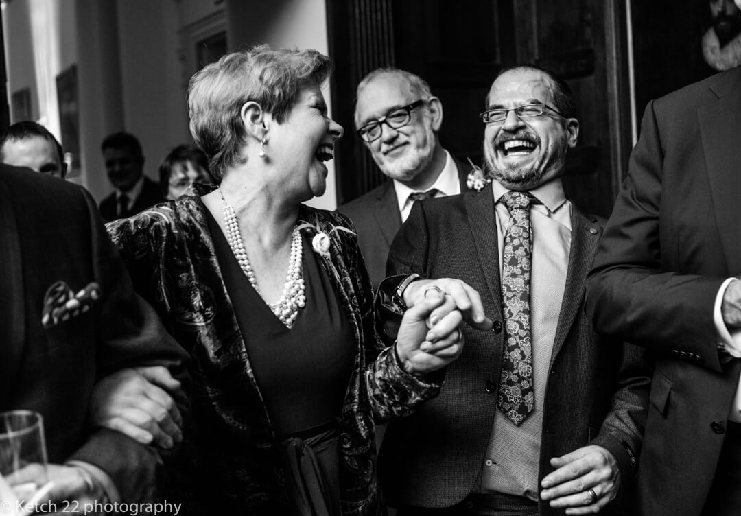 Mother of bride laughing with wedding guest