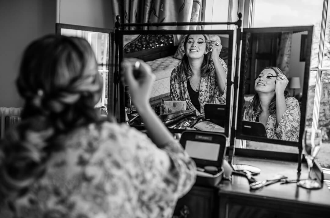 Documentary wedding photograph of bridesmaid getting ready