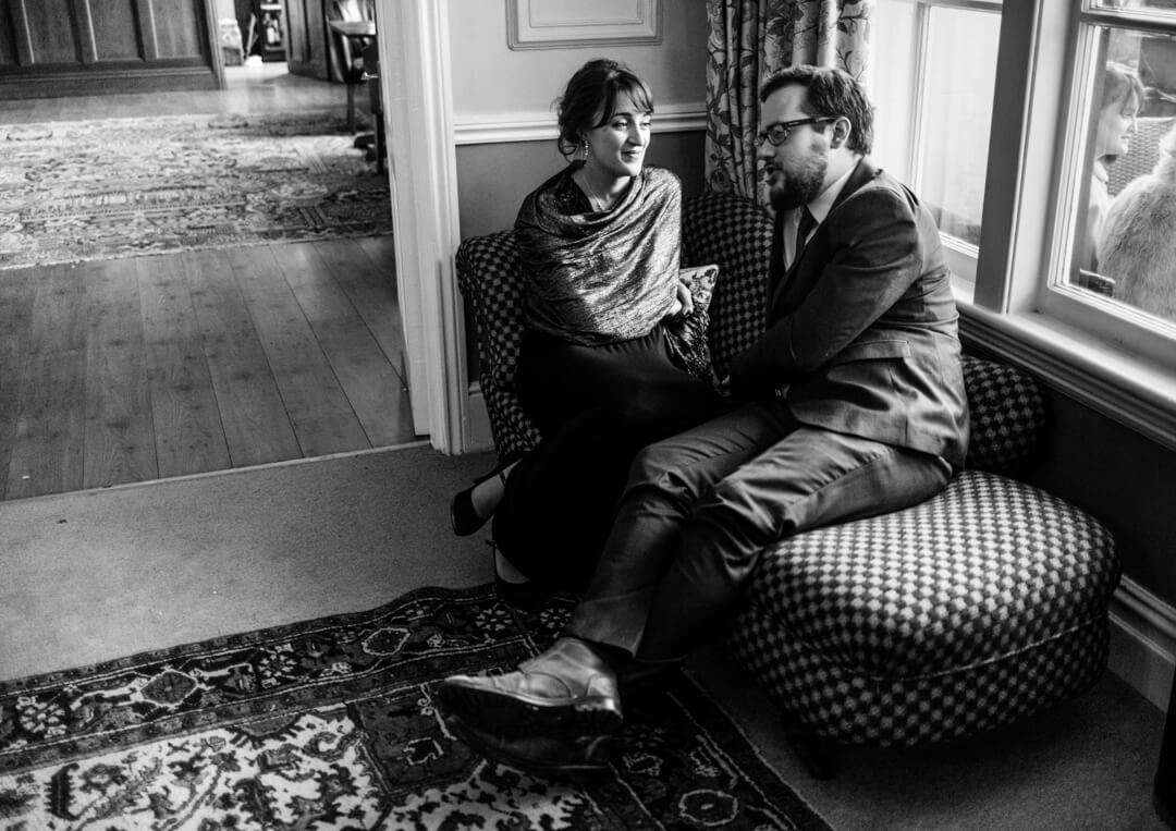 Documentary wedding photo of guests chatting