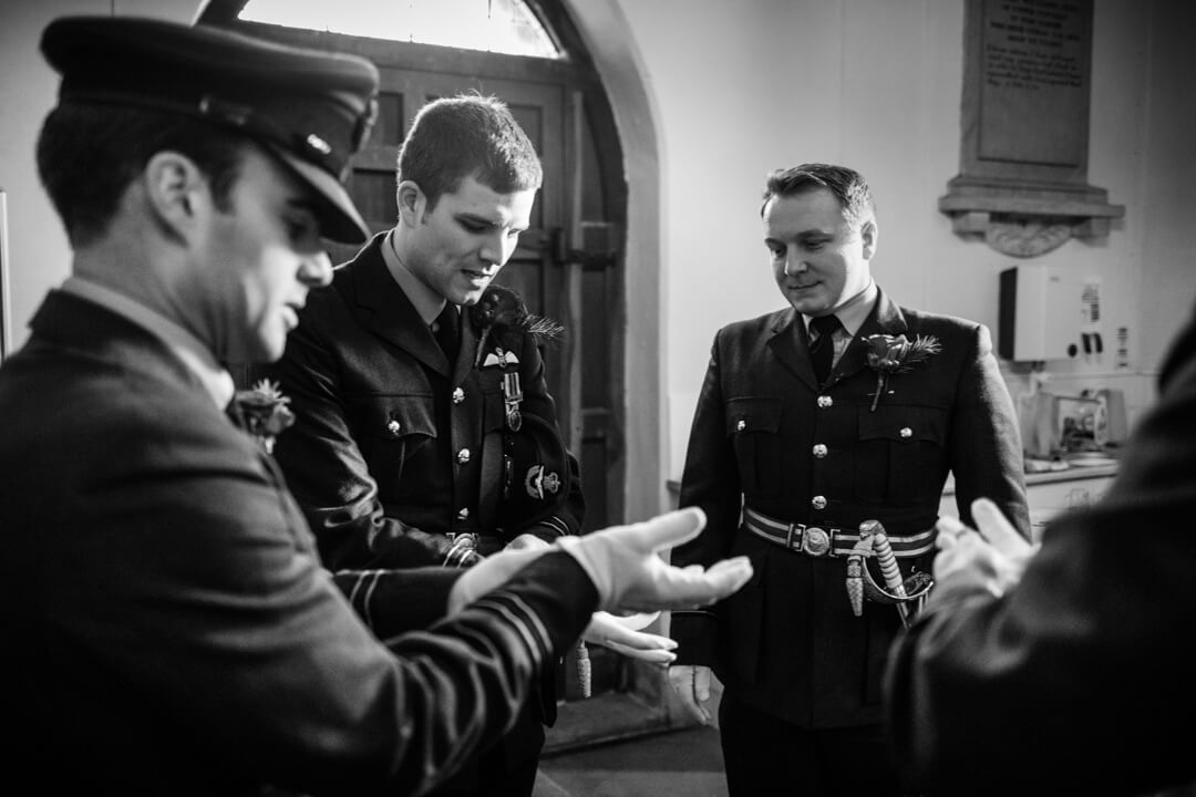 Groom and groomsmen in RAF uniform getting ready