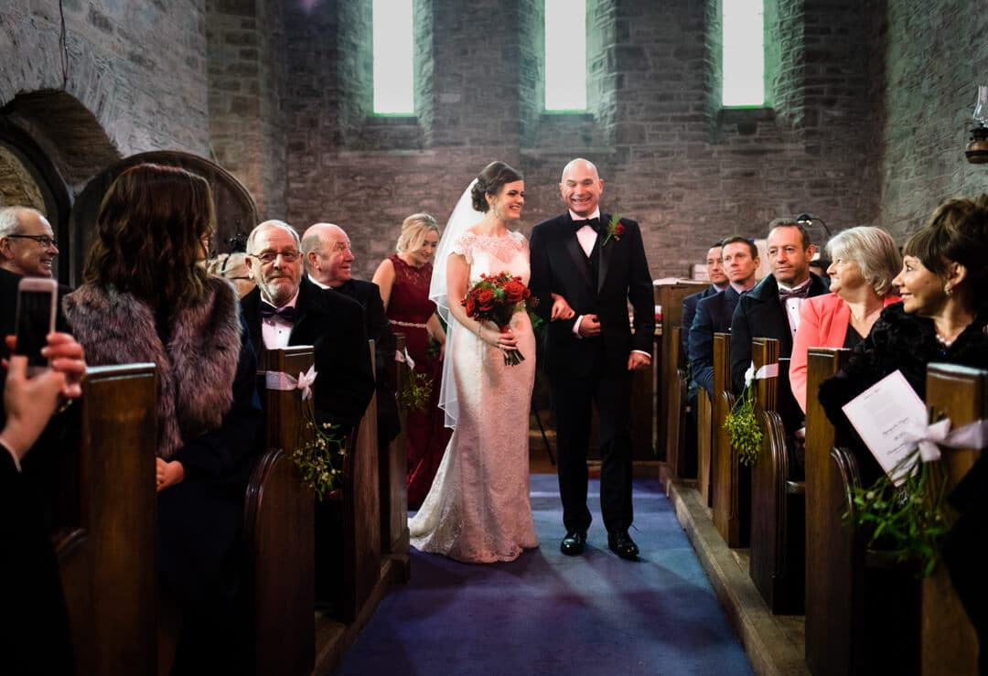 Bride and father entering church at Welsh wedding