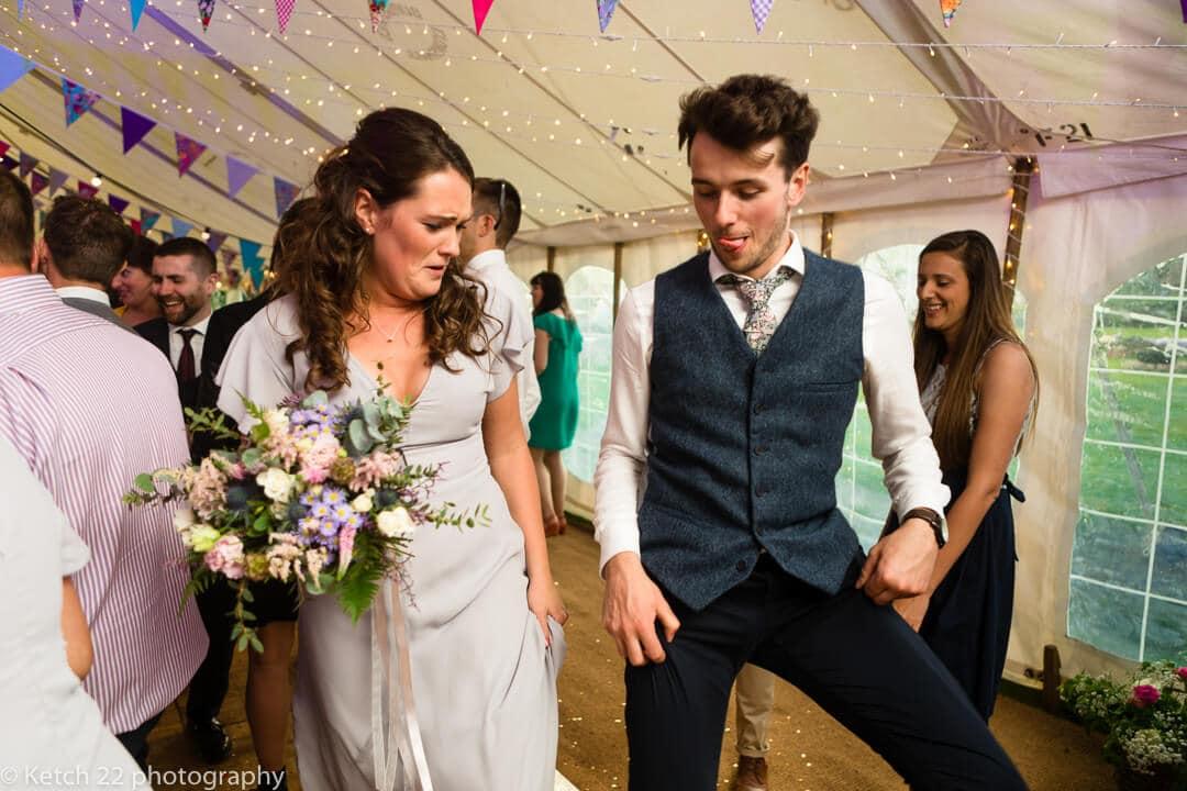 Groomsmen with blue waistcoat doing a strange dance