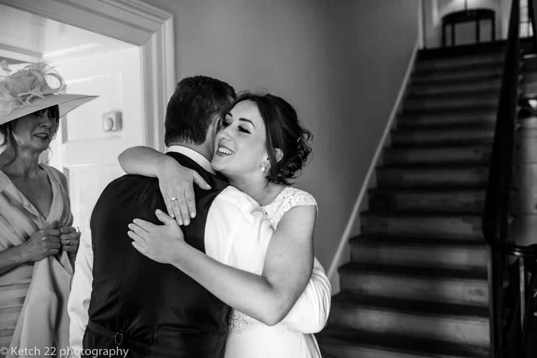 Bride hugging her Dad just before wedding ceremony