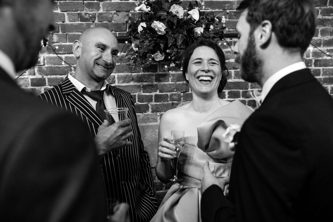 Wedding guests chatting and laughing