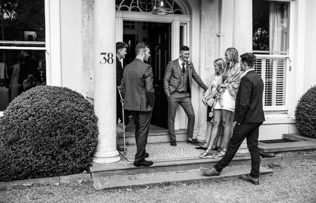 Wedding guests on the steps of No 38