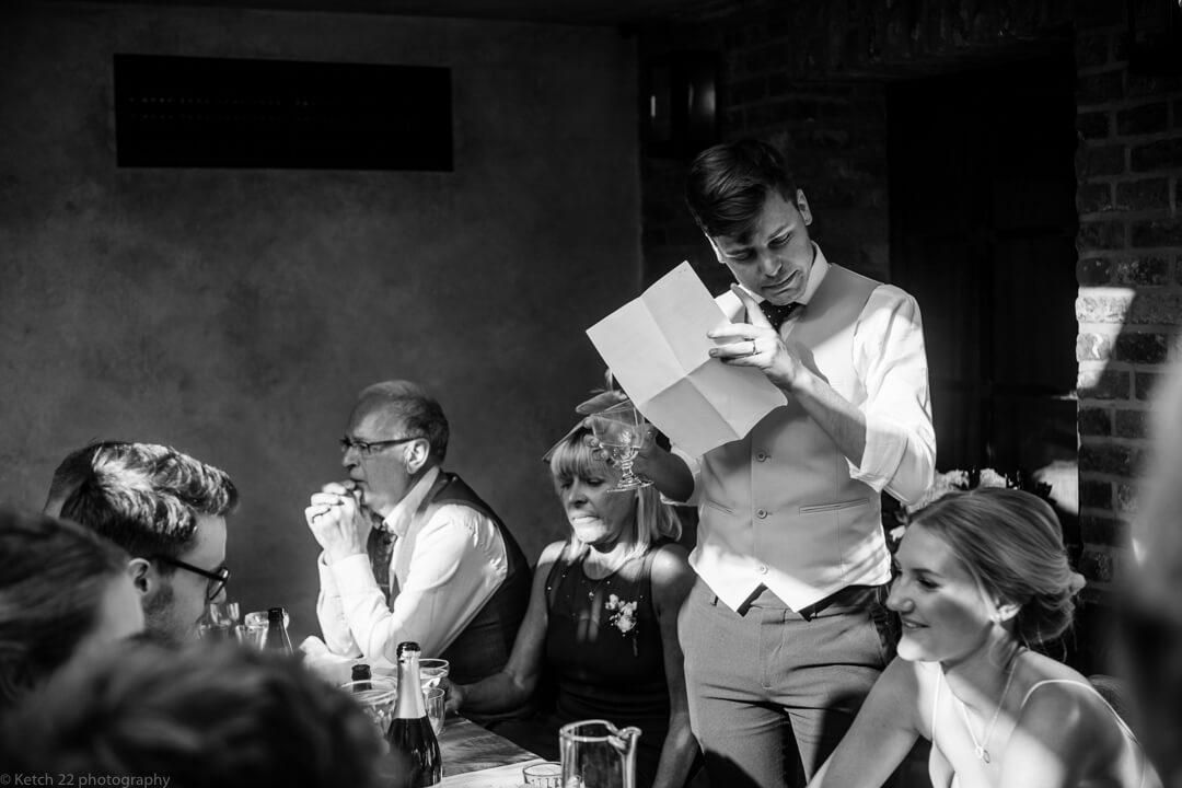 Groom making emotional wedding speech