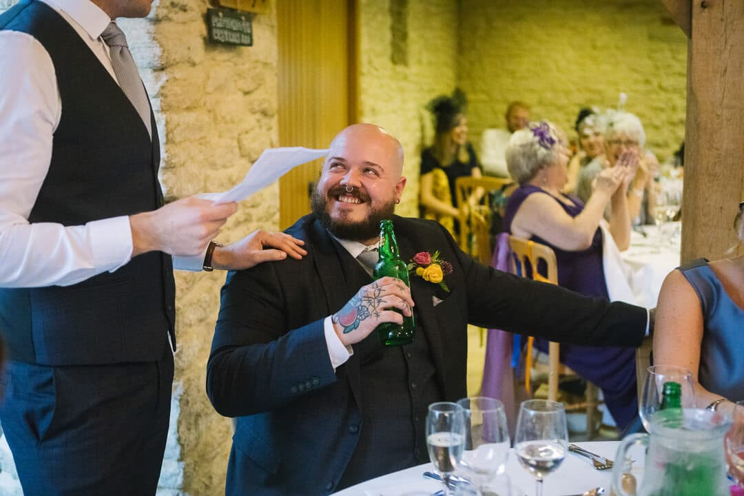 Best man laughing at Wedding speeches
