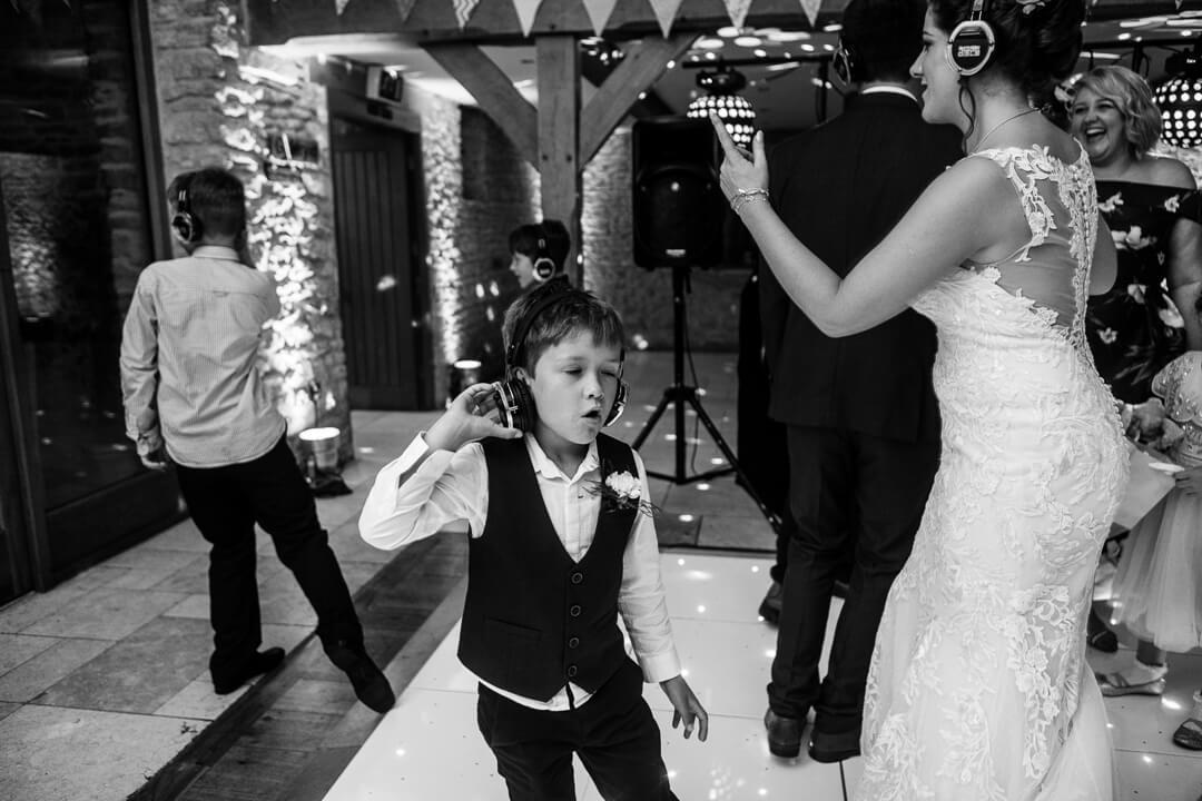 page boy dancing at Kingscote Barn wedding