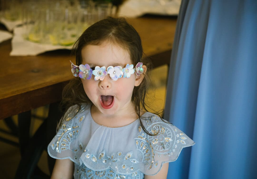 Flower girl making funny face at Tetbury wedding