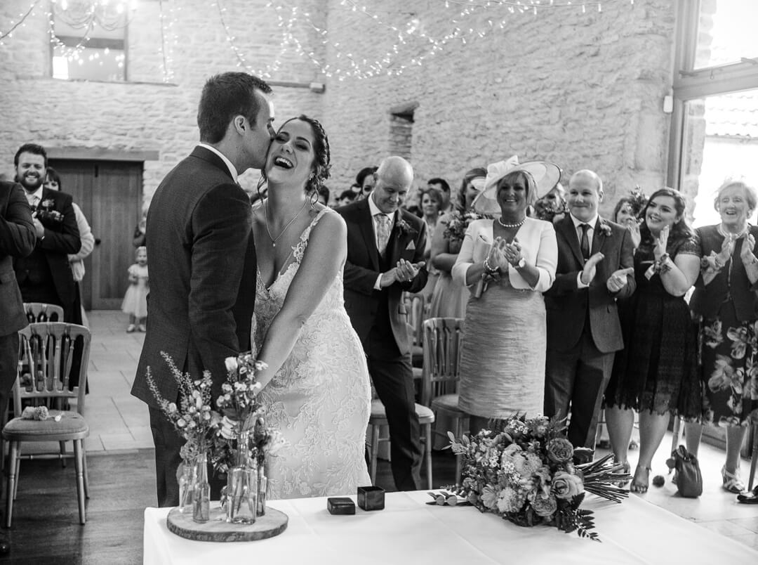 Groom looks at his bride for the first look at Cotswold Wedding