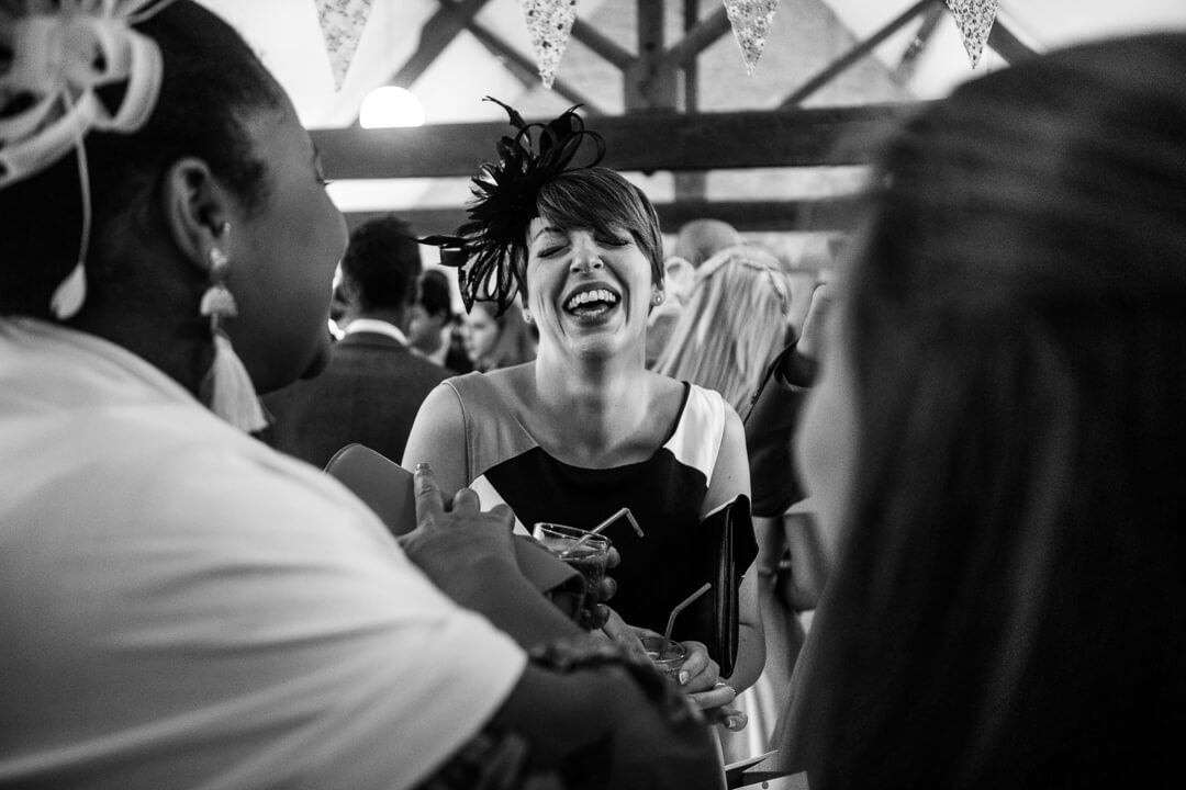 Wedding guest laughing at reception