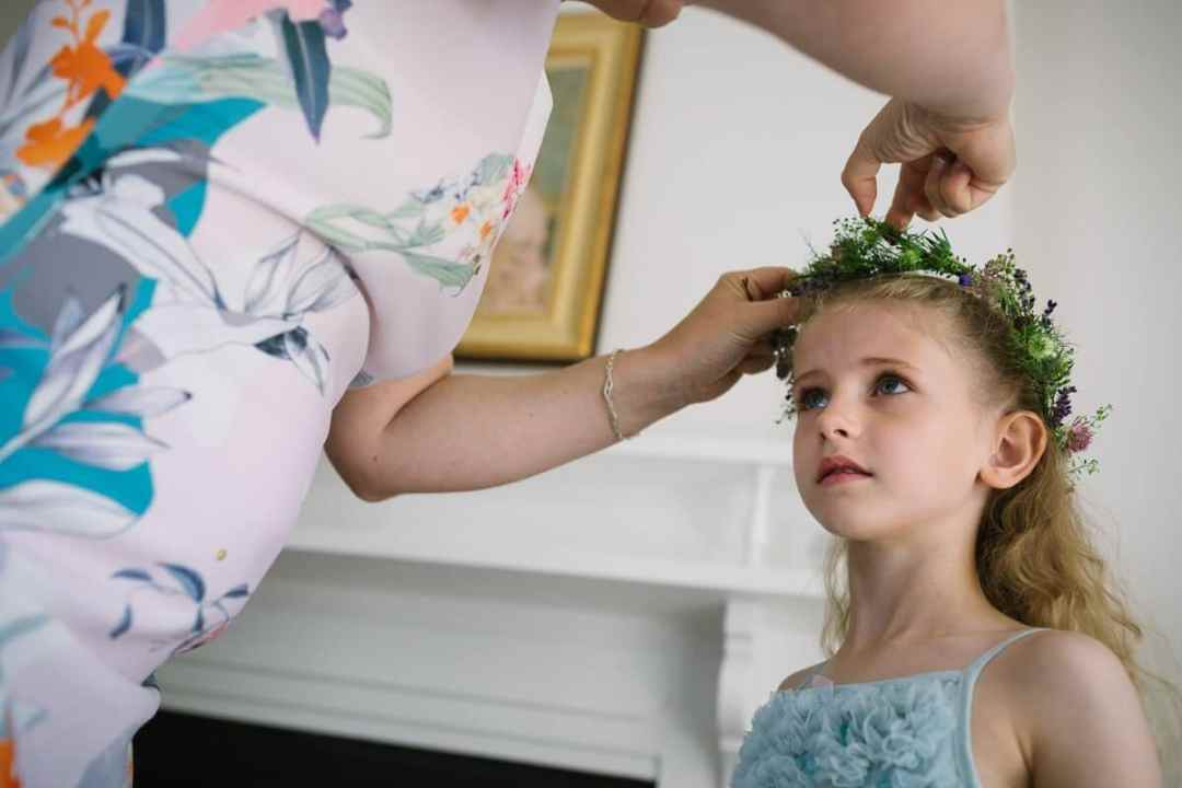 Flower girl getting ready at Cotswold wedding