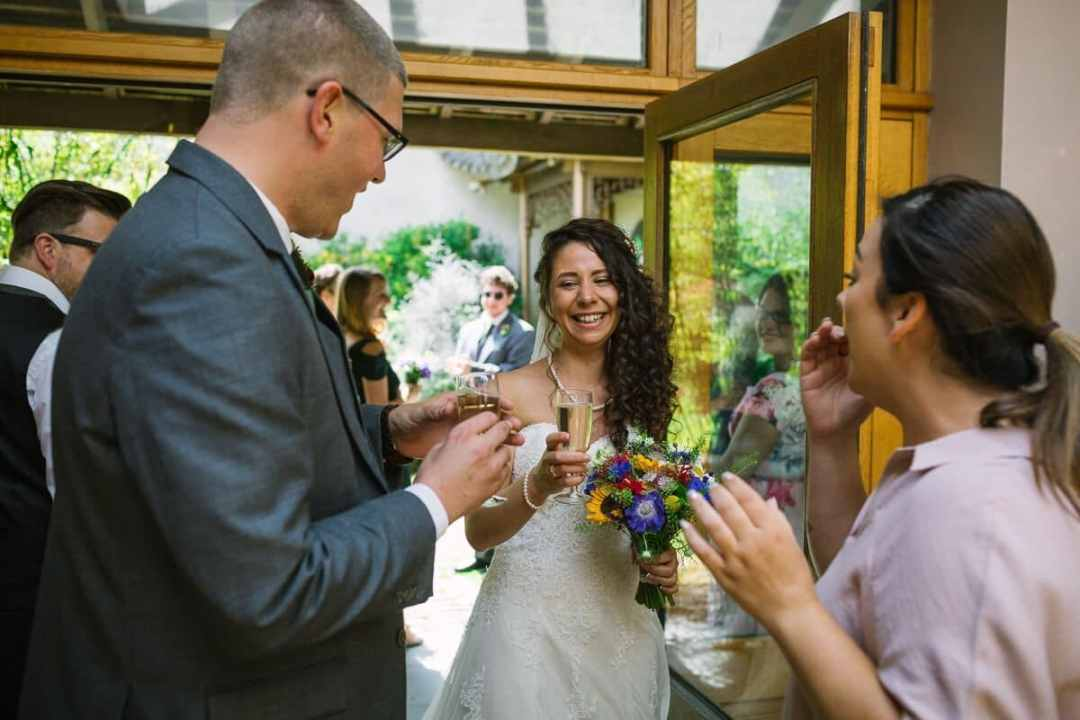 Bride and groom toast each other