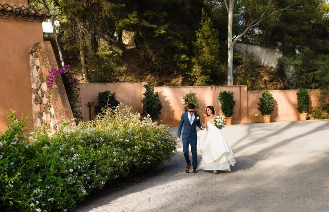 Bride and groom walking to venue at Wedding in Malaga Spain