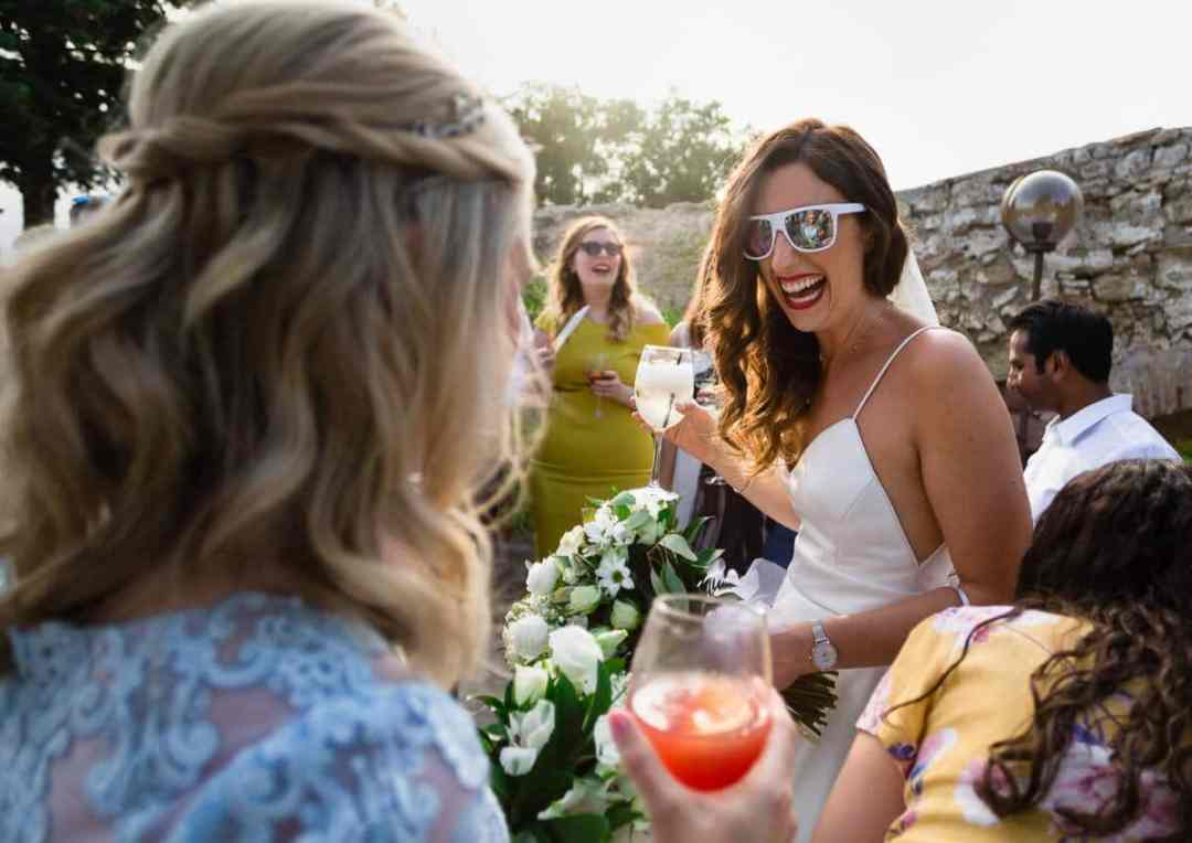 Bride wearing sunglasses and laughing