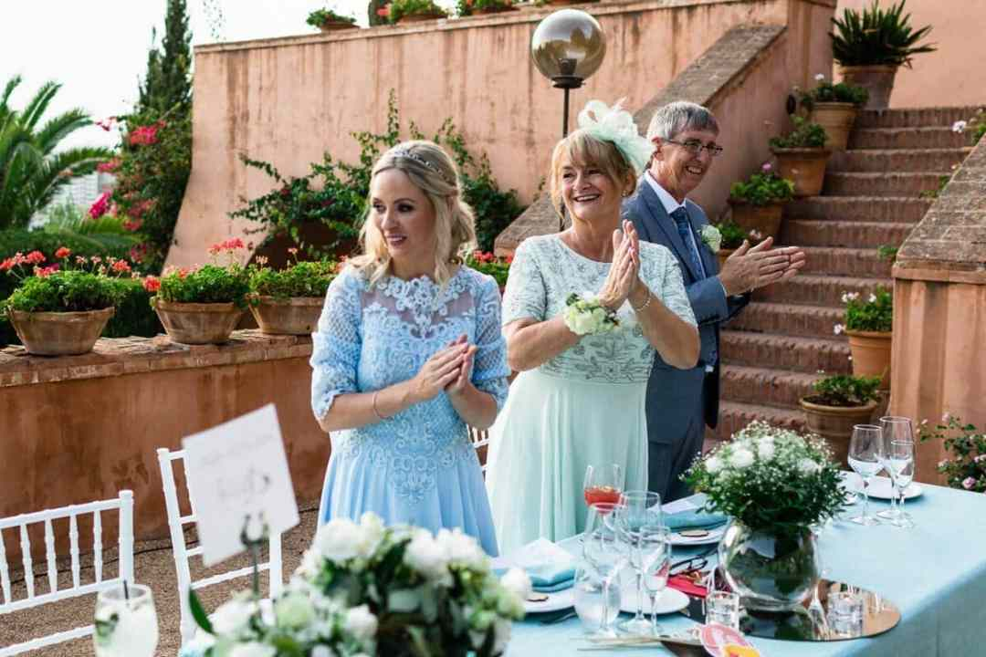 Family of bride clapping at Wedding breakfast