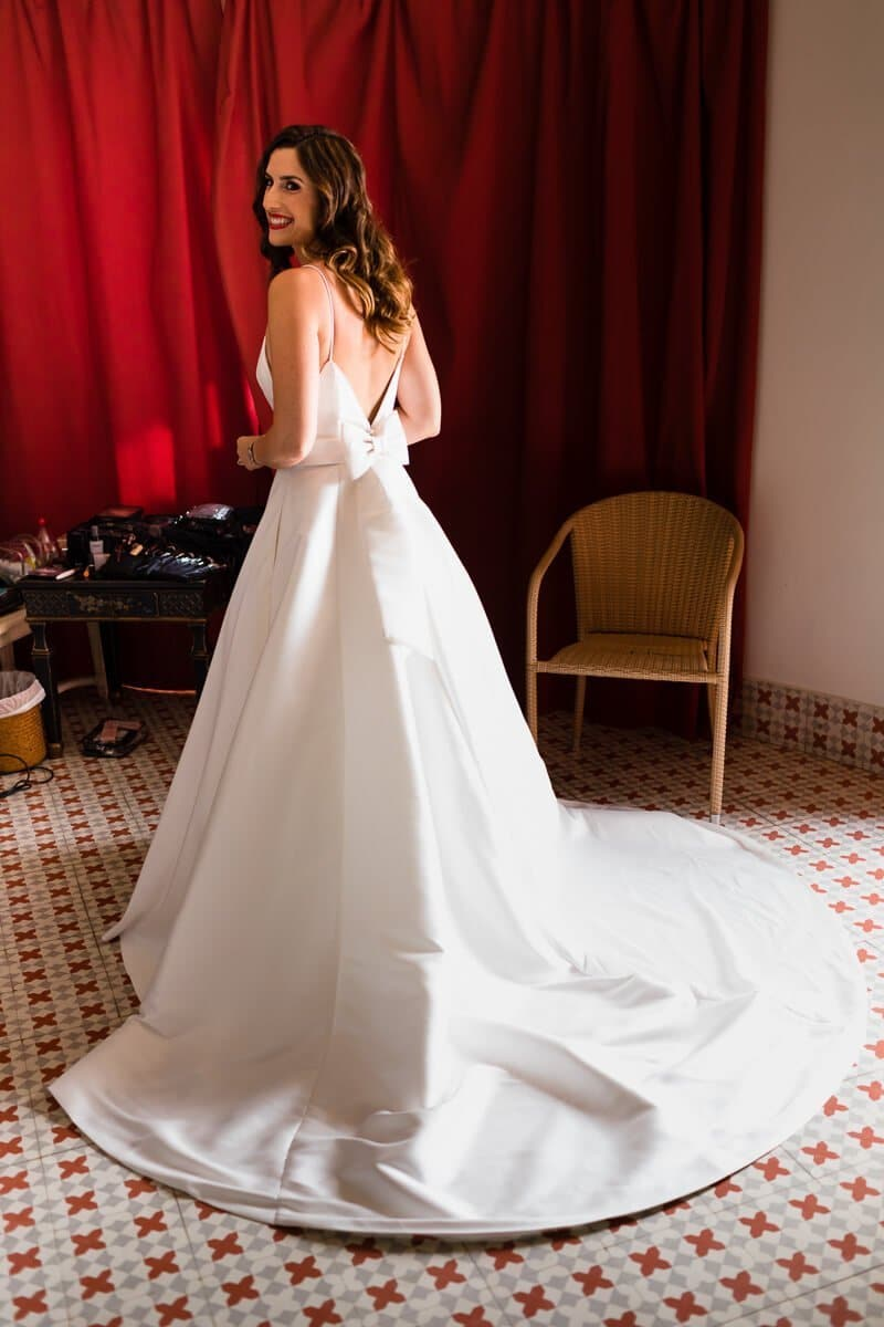 Portrai of bride with red back drop at Spanish Wedding
