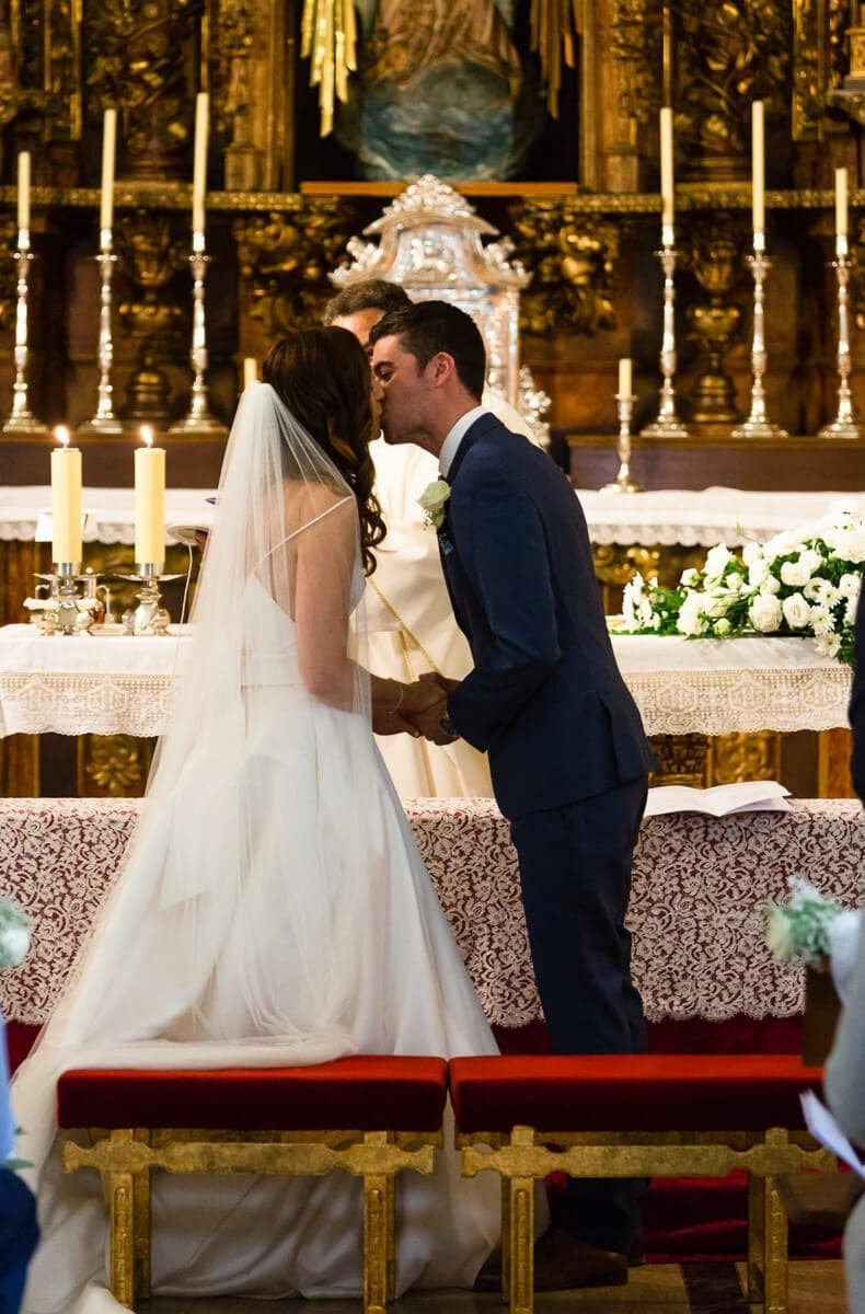 Brise and groom kissing at wedding ceremony