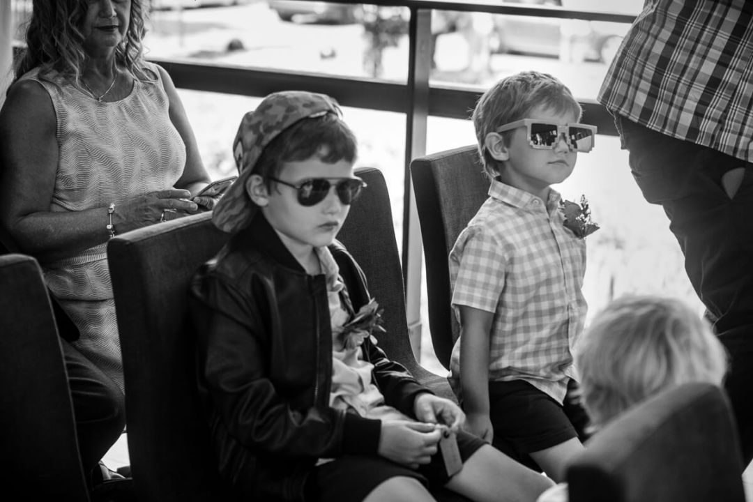 Kids wearing sunglasses at wedding ceremony