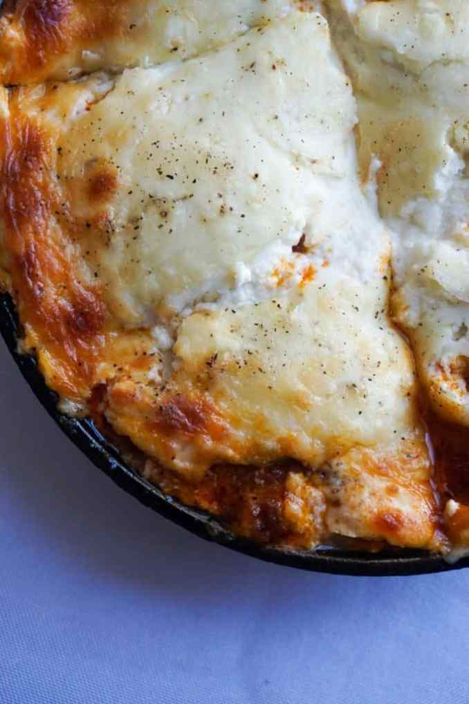 Freshly baked lasagna, gooey cheese, thick sauce