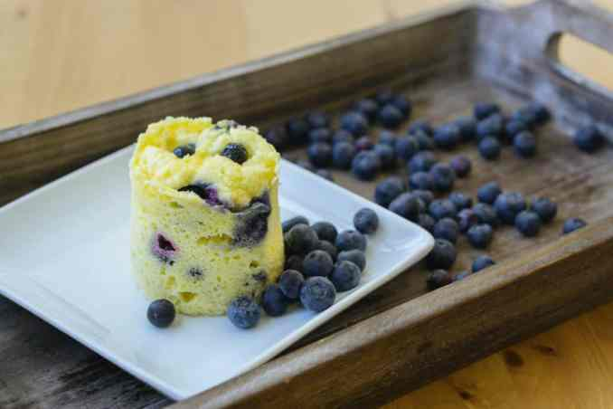 mug cake on a wooden serving tray