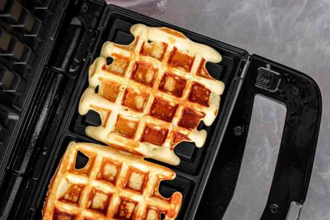 Cooked protein waffles ready to be removed from the iron