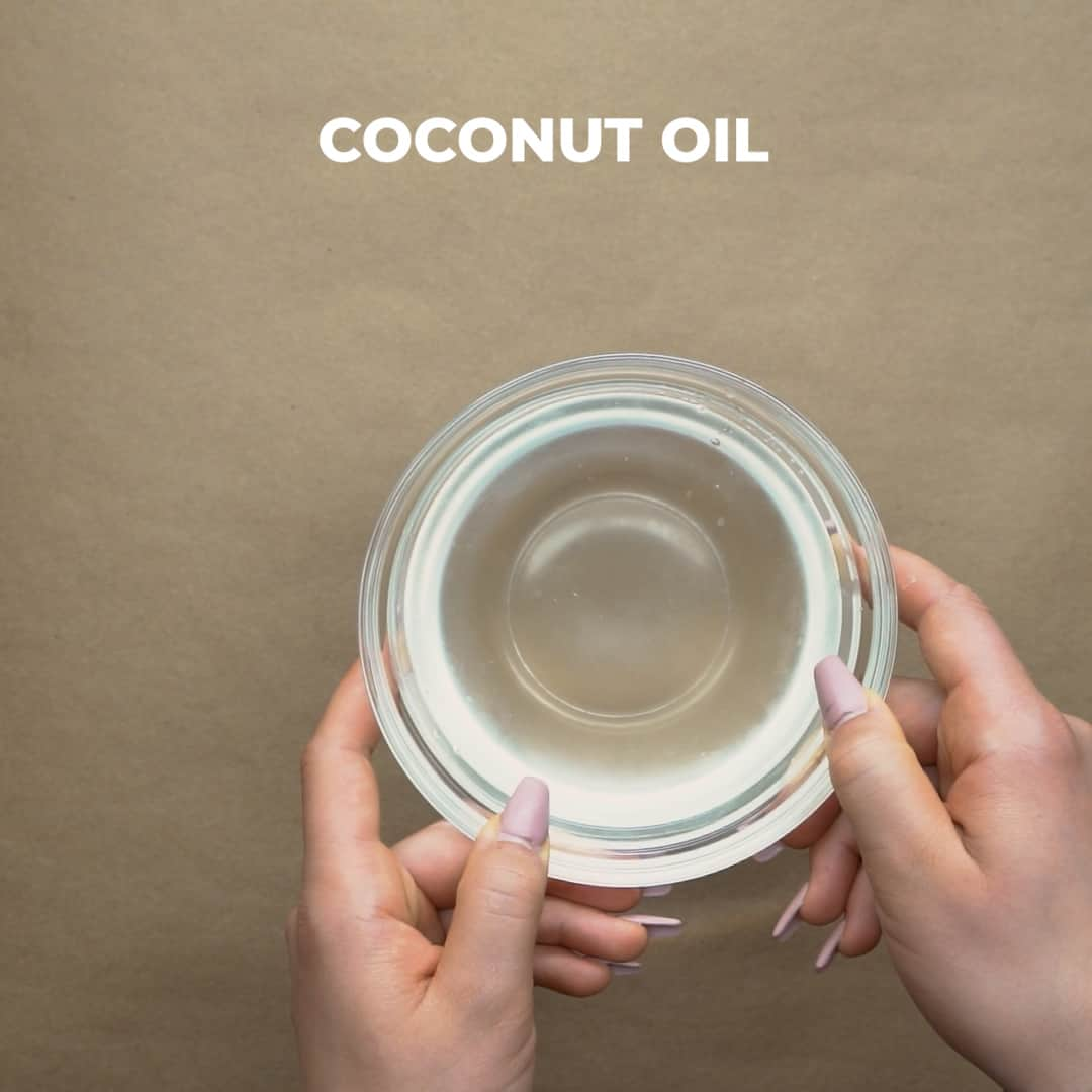 melted coconut oil in a small bowl