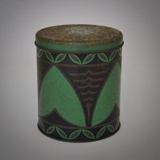 Vintage brocante industrieel blik middelgroot met patroon van groen en zwart met bruin of goede strepen