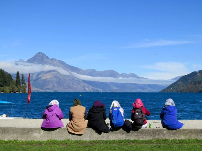 Tourists (women in headscarves) watching Lake Wakatipu, in Queenstown, New Zealand. ©KettiWilhelm2016