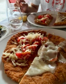 How to try as many dishes as possible in Italy? Split two with a friend, like these two styles of Italian Cotoletta alla Milanese. ©KettiWilhelm2017