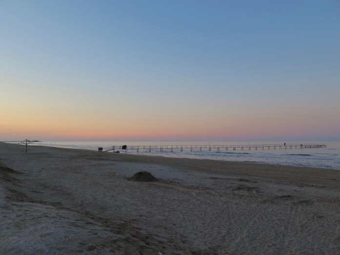 What is ferragosto? It's the opposite of this calm, quiet sunset on the beach in Rimini, Italy. (At ferragosto, it's guaranteed to be packed with crowds.) ©KettiWilhelm2018