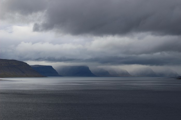 Dark layered clouds over a row of mountains over a bay in Western Iceland. ©KettiWilhelm2018