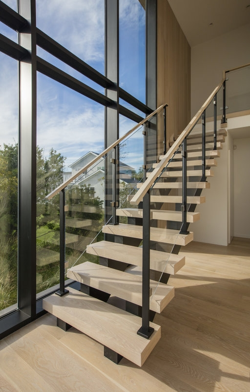 Custom Glass Railing For Stairs And Decks Keuka Studios   Stair Railing Design Glass   Steel Stair   Oak Staircase   Steel   Staircase Remodel   Stainless Steel Railing