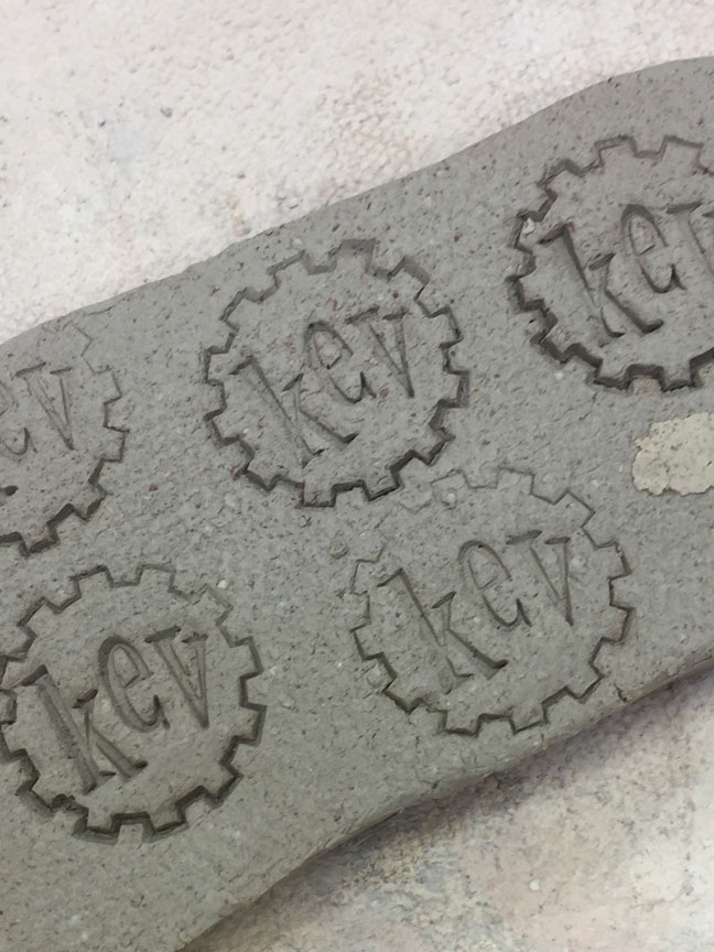 """""""kev"""" clay stamp for Kevin Eaton"""