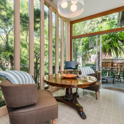 The mid-century breakfast nook opens out directly onto  the lovely deck and receives filtered sunlight most of the day.
