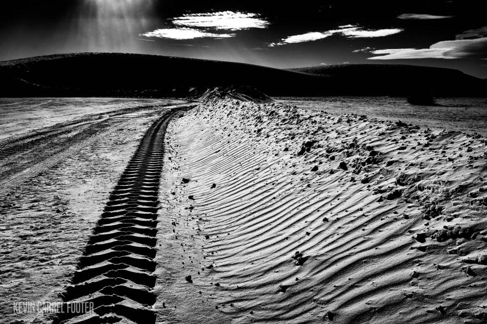 tire tracks, white sands