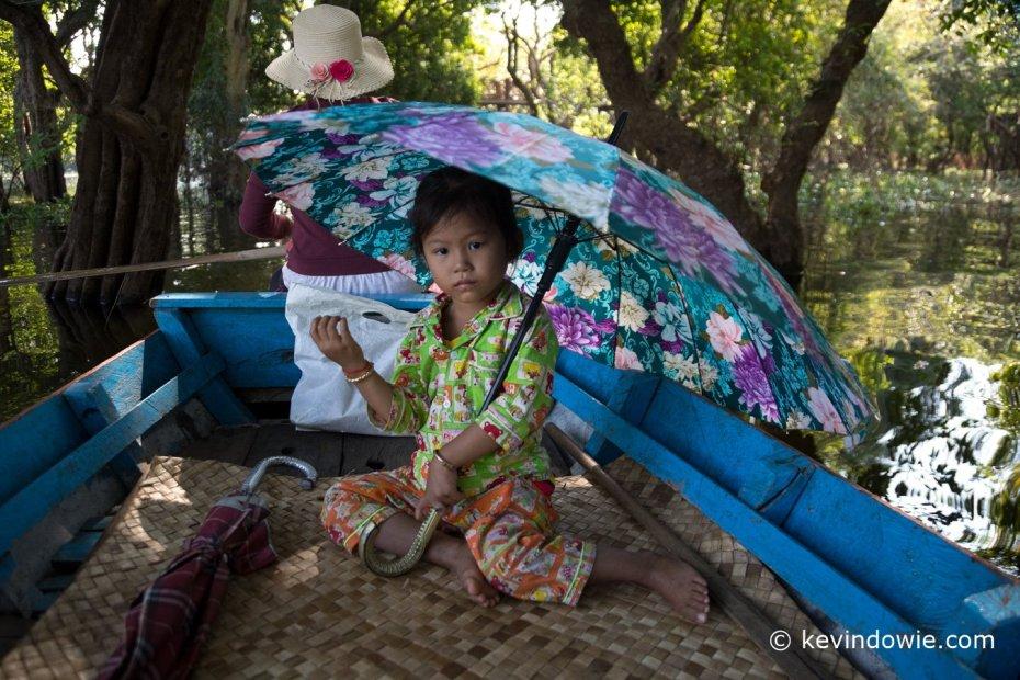 Young girl under umbrella