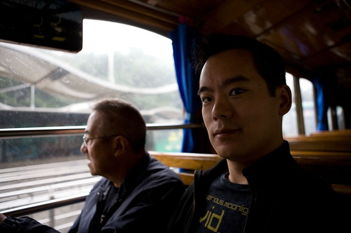 Dad on I on the Y2 tourist bus that tools around Hangzhou's West Lake.