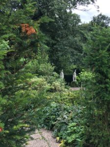 Statues guarding woodland entrance Renishaw
