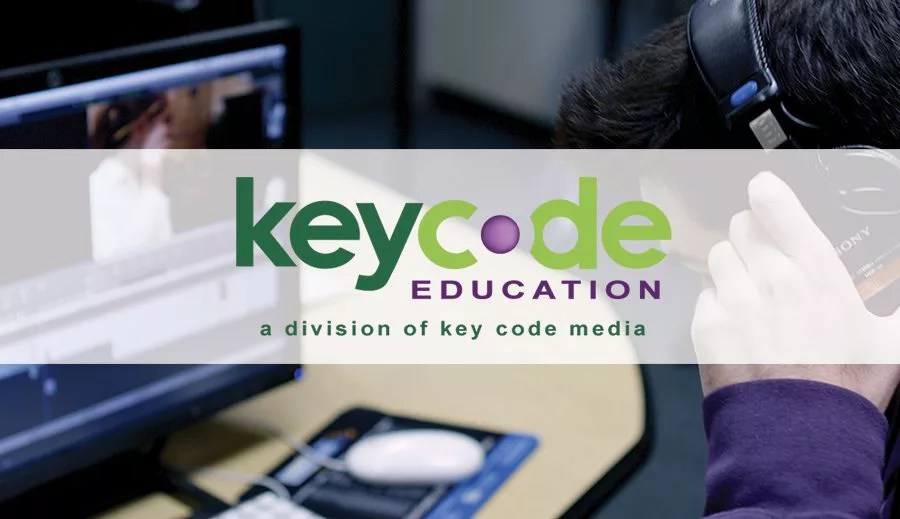 Key-Code-Education Banner over student