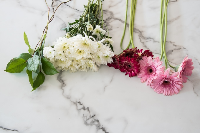 Easy method for creating professional looking flower arrangements and bouquets using grocery store flowers!