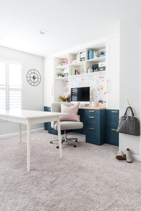 home office craft room built-in desk IKEA SEKTION cabinets pink pillow hanging purse and shoes