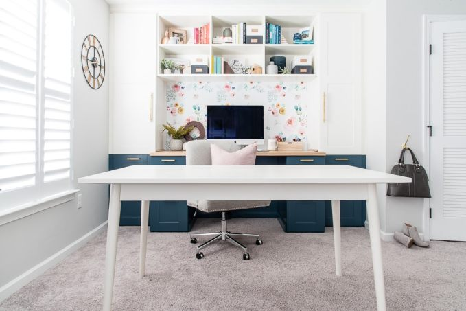 white dining room table in craft room home office built-in desk