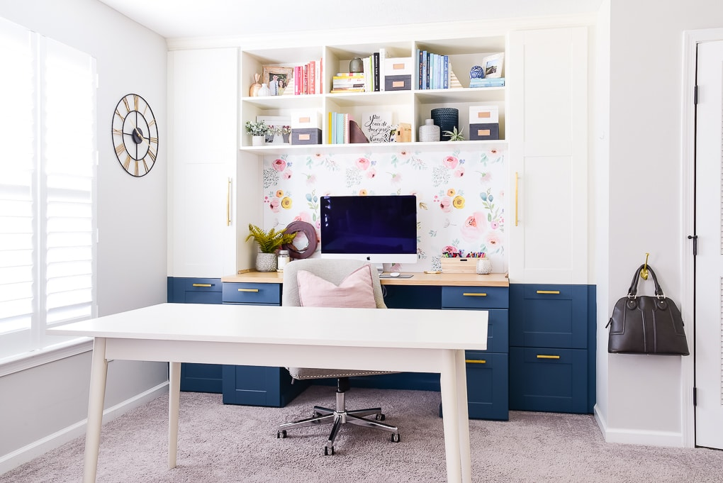 modern creative desk with imac computer and shelf decor