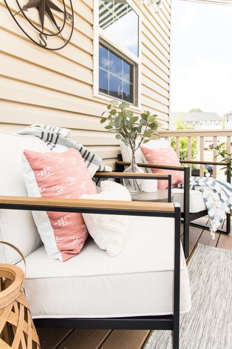 modern outdoor chairs and accessories on outdoor porch
