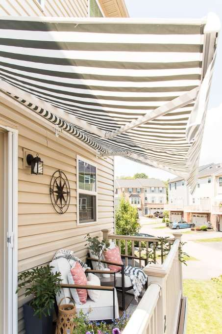 blue and white striped awning on outdoor porch on townhome