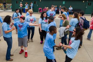 Students and staff dancing.