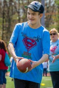 Student handling football.