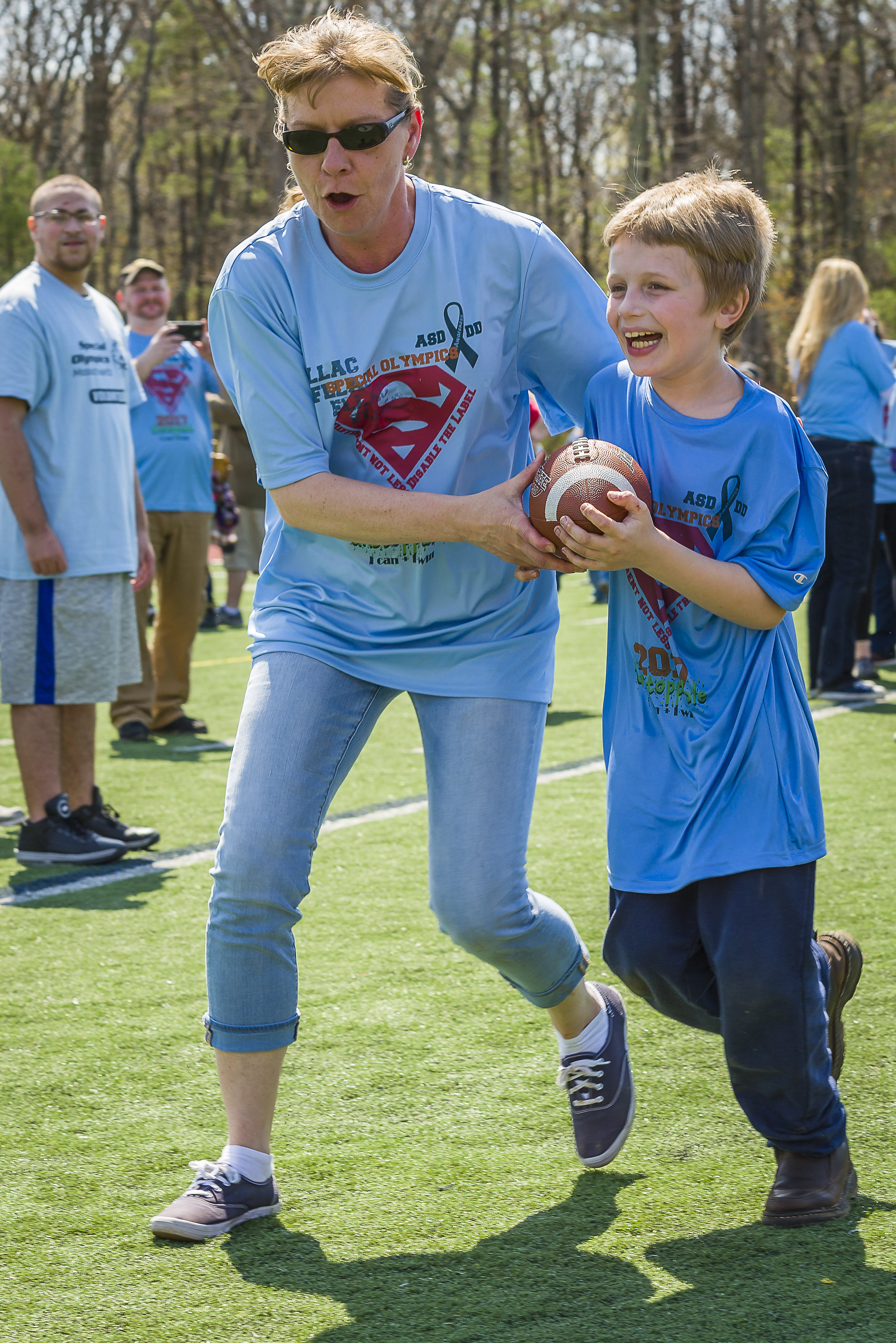Student running with football.