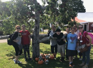 Classroom picture with their apples and pumpkins.
